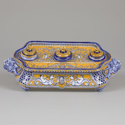A majolica inkstand decorated with putti seated on sea monsters and various lion…