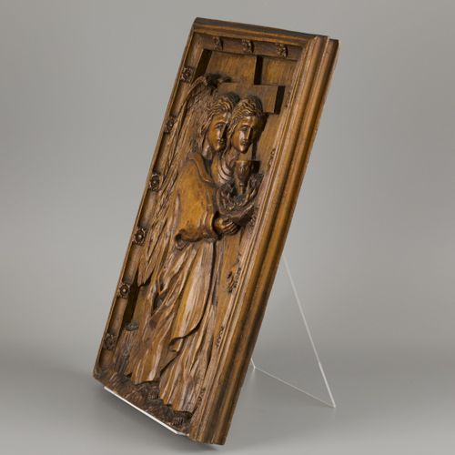 An carved oak bas relief depicting St. John the Baptist with arma sacra, ca. 190…