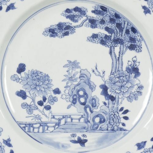 A porcelain dish with floral decor on the outside edge and in the middle a pictu…