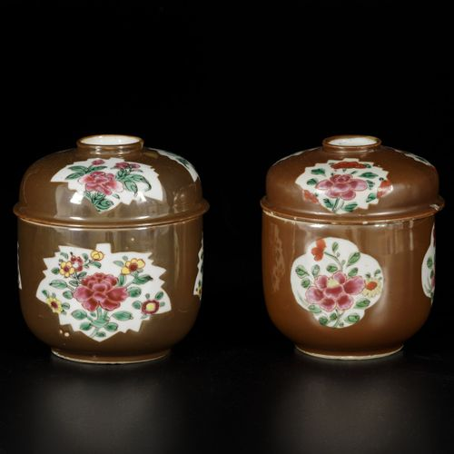 A lot of (2) porcelain lidded pots with famille rose decor on capucine fond, Chi…