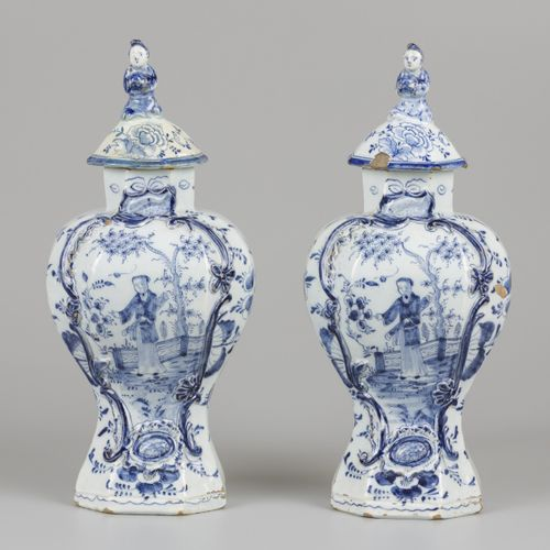 A set of (2) earthenware lidded vases with chinoiserie decoration, marked Het Fo…