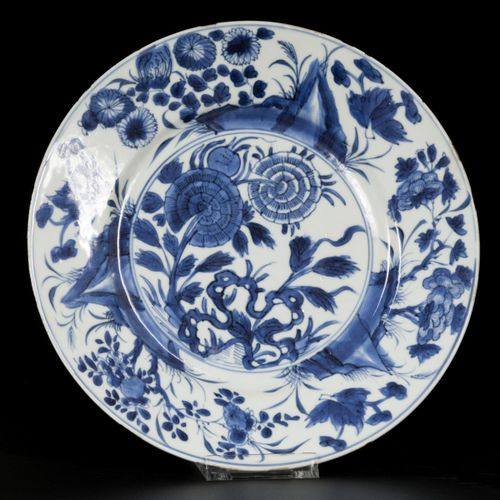 A set of (3) porcelain plates with floral and rock decoration, China, Kangxi. Di…