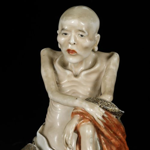 A porcelain sculpture of a philosopher, China, 19th/20th century. 21 x 13 cm. Do…