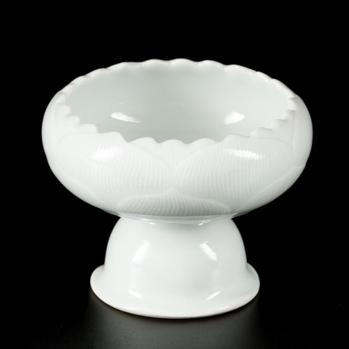 A porcelain celadon glazed votive cup decorated with lotus leaves, China, 20th c…
