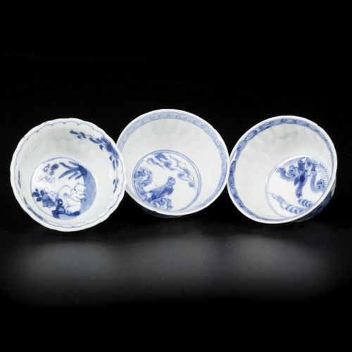 A lot of (3) porcelain cups, two with floral decoration and bird, one with hare …