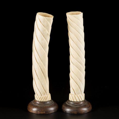 A set of (2) sculpted elephants teeth, DRC, 1st halft 20th C. H. 35,4 cm. Y comp…