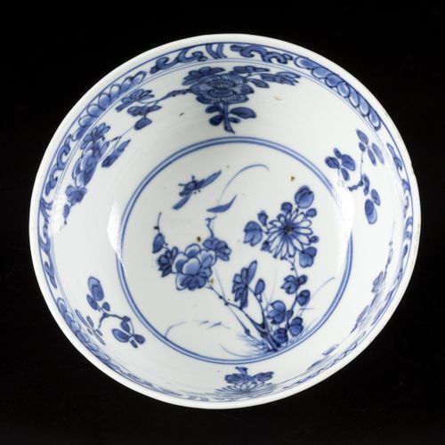 A porcelain bowl with capuchin exterior and floral decoration in the interior, m…