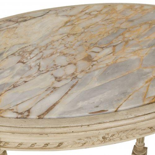 A Louis XVI style oval table, France, late 19th century. 椭圆形的大理石台面上面有一个带玫瑰花的异形基座…