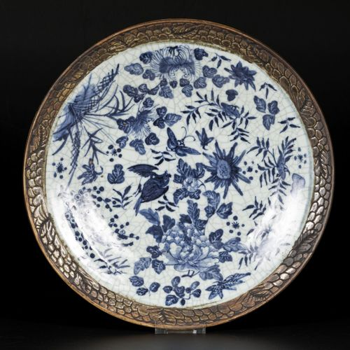 A porcelain charger with floral decorations, bird and butterflies, China, 19th c…