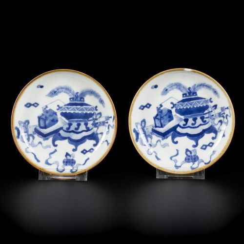 A set of (2) small porcelain saucers decorated with antiquities, marked Lingzhi,…