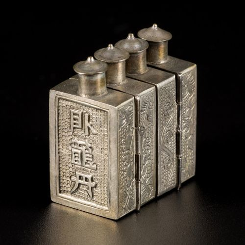 A lot comprising (2) Tibetan silver snuff bottles with floral decoration and cha…