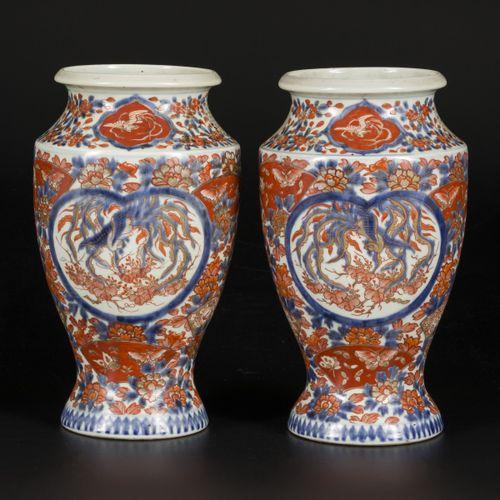 A set of (2) porcelain vases with Imari decoration, marked underneath, Japan, 19…