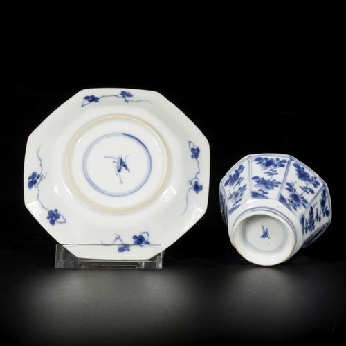 A porcelain cup and saucer, angled model with floral decorations, China, Kangxi.…