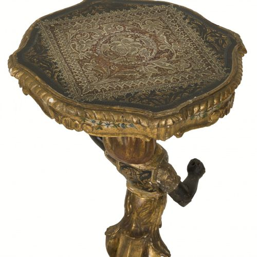 A carved wooden gueridon/ winetable with depiction of a blackamoor, Southern Eur…