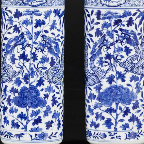 A set of (2) porcelain cylinder vases with dragon decoration, marked Kangxi, Chi…