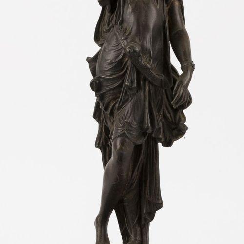 A ZAMAC female figure on a stone base, ca. 1900. 各种缺陷。  高:56.5厘米。