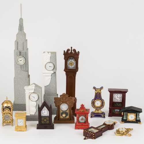 A lot consisting of miniature clocks in the shape of a standing watch and pendul…