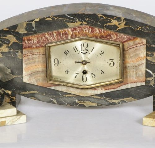 An Art Deco mantle clock and (2) sets of bookends, 2nd quarter of the 20th centu…