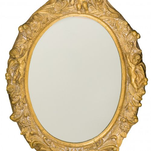 An oval gold painted mirror frame with decorative relief, 2nd half 20th century.…