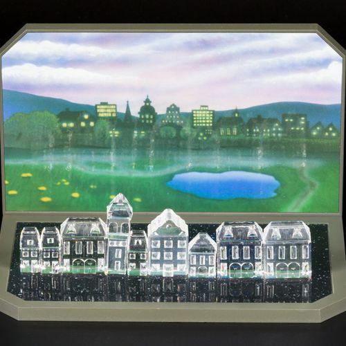 (6) piece lot Swarovski miniatures Comprenant : Diverses maisons avec un présent…