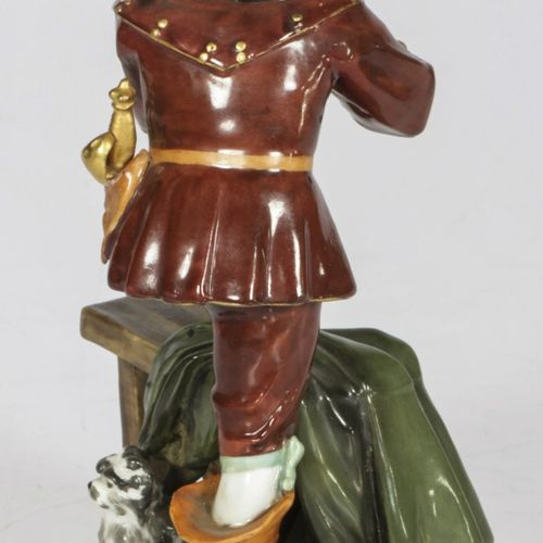 A porcelain Rudolstadt figurine of a musketeer packing his pipe, Germany, 20th c…