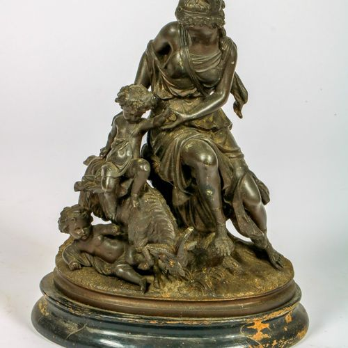 A ZAMAC sculpture of a mother and child, playing with a buck goat, 20th century.…