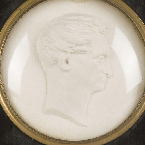 A 19th C. Plaster relief plaquette (tondo) portrait of a man behind concave glas…