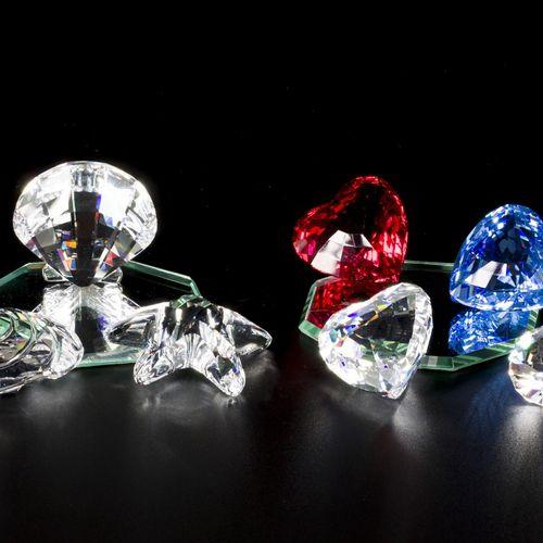 (9) piece lot of Swarovski miniatures Composé de coquillages, de cœurs, d'étoile…
