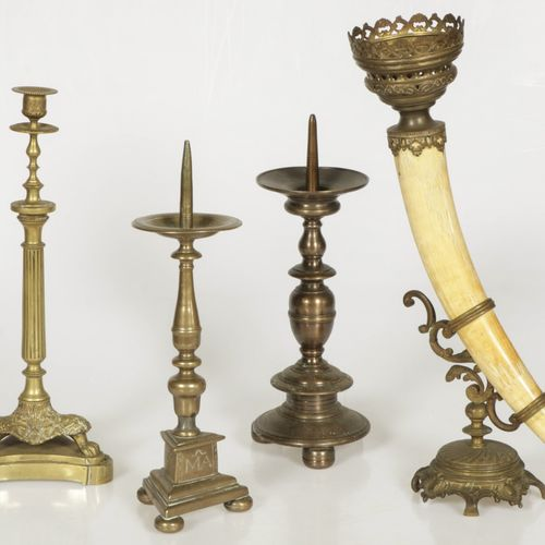 A lot of various bronze candlesticks and a horn with bronze fittings, 19th centu…