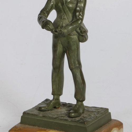 A bronze sculpture of a tradesman/ colporteur, France, 2nd quarter 20th century.…