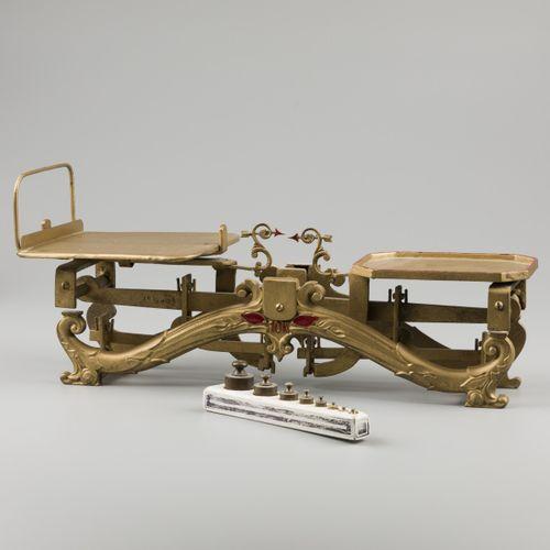 A set of scales on a cast brass pediment, Sweden, 19th century. Mit nicht überei…
