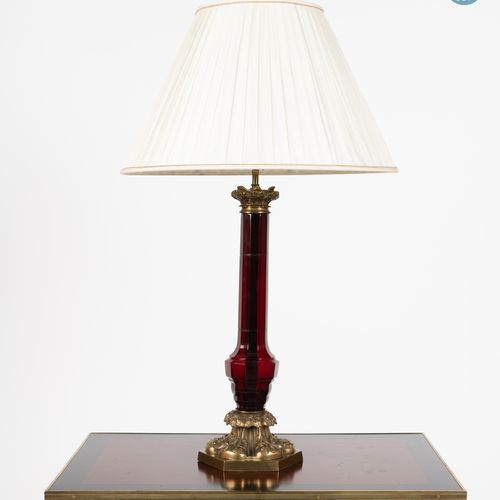 From a prestigious Parisian Palace Gilt bronze lamp with a baluster shaft with r…