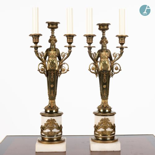 From a prestigious Parisian Palace Pair of chased and gilded bronze candelabra w…