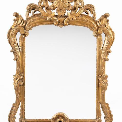 From a prestigious Parisian Palace Pair of moulded, carved and gilded wooden mir…
