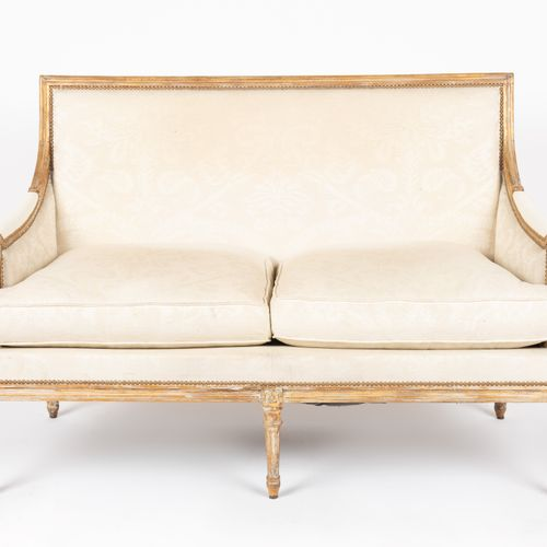 From a prestigious Parisian Palace Pair of moulded, carved and gilded wooden sof…
