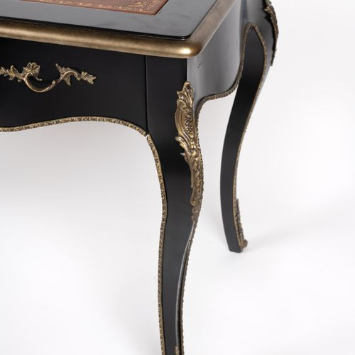 From a prestigious Parisian Palace Black lacquered wooden desk, three drawers in…