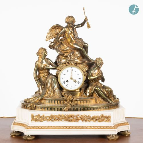 From a prestigious Parisian Palace Gilt bronze clock and white marble base, surm…