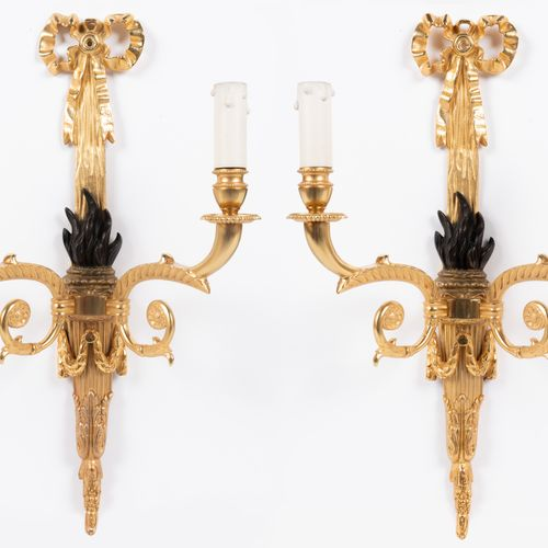 From a prestigious Parisian Palace Pair of two arms sconces in gilt and patinate…