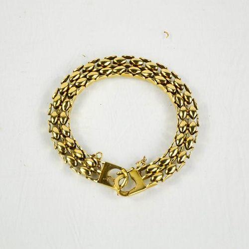 Un bracelet à maillons ovales en or 14ct (testé comme) avec chaîne de sécurité, …