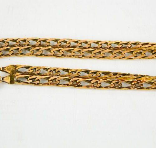 Un collier à maillons en or 9ct 19.2g.