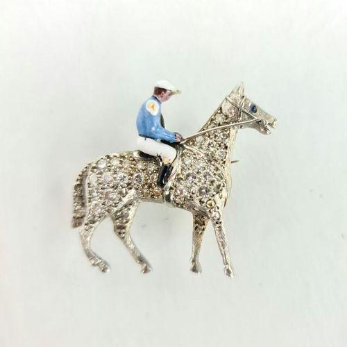 Une broche en platine, diamant et émail en forme de cheval et jockey, le cheval …