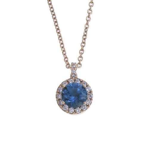 NECKLACE WITH BLUE QUARTZ AND BRILLIANT PENDANT. 18kt yellow gold with a blue qu…