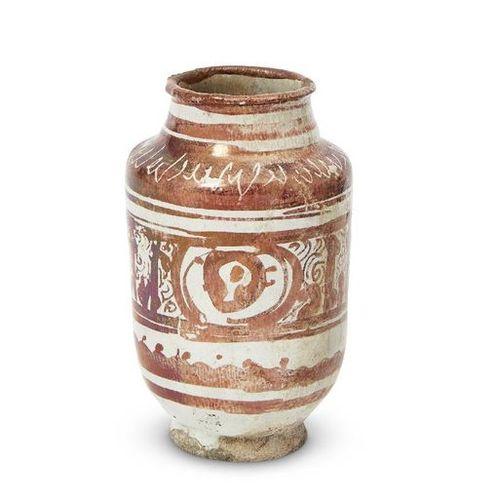 A small copper lustre decorated albarello, Kashan, Iran, late 12th century, on a…