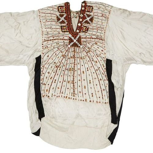 An embroidered silk robe, Egypt, 19th century, of white silk with button and gre…