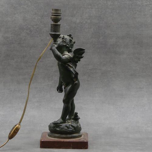 M. MOREAU, Putto à la torche M. MOREAU, Putto à la torche, bronze à patine verte…