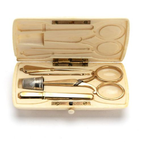 A 14K sewing set in ivory case A 14K sewing set in ivory case, A rectangular sol…