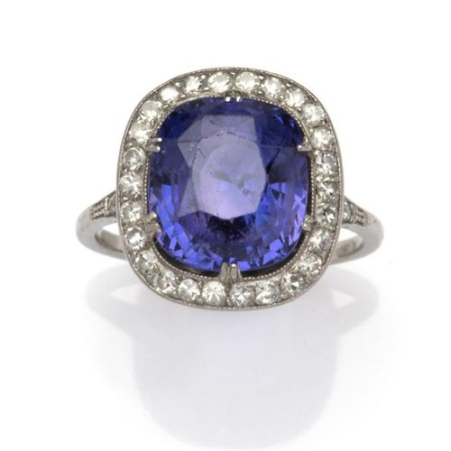 A Sapphire and Diamond Ring A sapphire and diamond ring, Set with a violet colou…