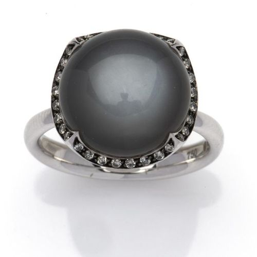 An 18k white gold moonstone and diamond ring An 18k white gold moonstone and dia…