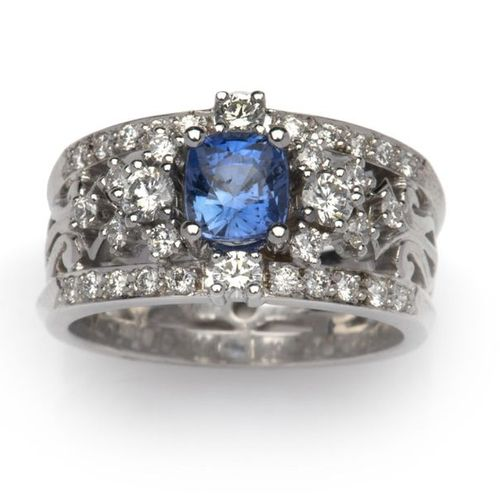 An 18k white gold sapphire and diamond dress ring An 18k white gold sapphire and…