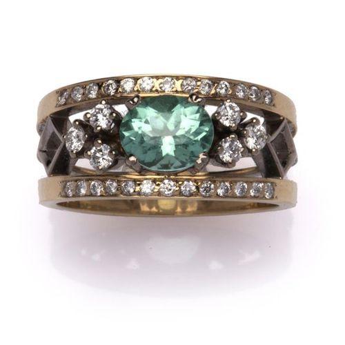A 14k gold tourmaline and diamond dress ring A 14k gold tourmaline and diamond d…